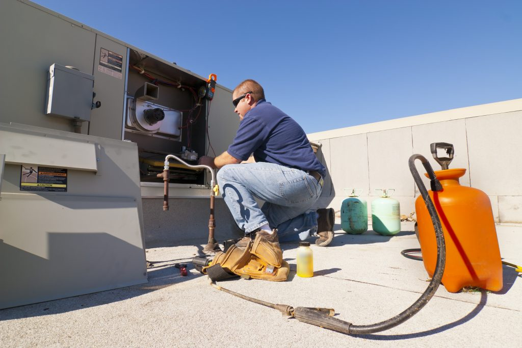 Commercial Electricians Works On HVAC Unit